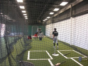 Indoor Batting Cage; visible to all fans to watch